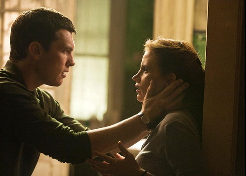 Sam Worthing and Jessica Chastain in The Debt